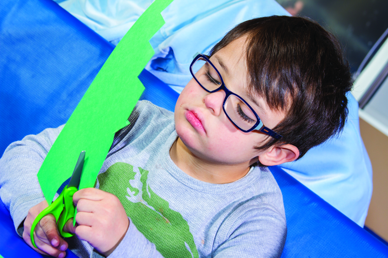 Using a scissors to cut shapes is just one tool Pediatric Therapy Center uses in its occupational therapy program. Cutting shapes will help develop fine motor skills.