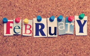 February on a cork board with push pins