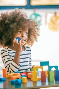Girl with blocks | About Pediatric Physical therapy