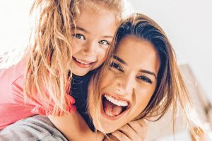 Little Girl hugging mother | Occupational Therapy