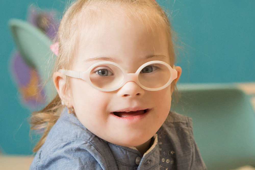 Little Girl with down syndrome wearing pink Glasses | Physical Therapy